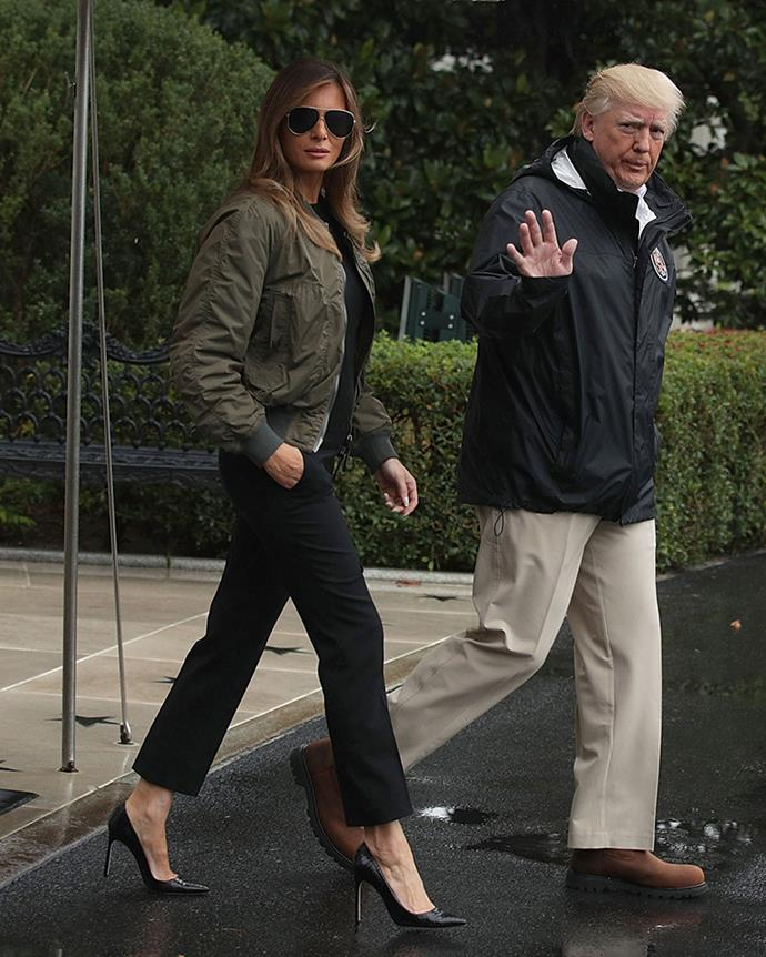 """**1. Dress Appropriately For Solemn Engagements** <br><br> Before there the """"I really don't care"""" coat, Melania landed in hot water for another insensitive outfit choice. In 2017, Donald and Melania Trump visited the Hurricane Harvey relief headquarters in Texas, but it wasn't long before Melania's outfit—which included a khaki bomber jacket and a pair of black leather Manolo Blahnik pumps—received backlash for being inappropriate (or at the very least impractical) for a disaster zone. Melania changed into Stan Smith sneakers before disembarking in Texas."""