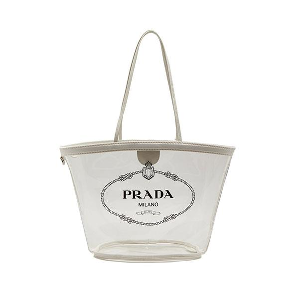 """The best part about Prada's perspex beach tote? It's versatile enough to incorporate into your non-European wardrobe once you return home, with PVC and transparent accessories asserting themselves as one of 2018's biggest trends.  <br>br> Handbag by Prada, $1,370 at [MATCHESFASHION.COM](https://www.matchesfashion.com/au/products/Prada-Logo-print-plexi-tote-1205783