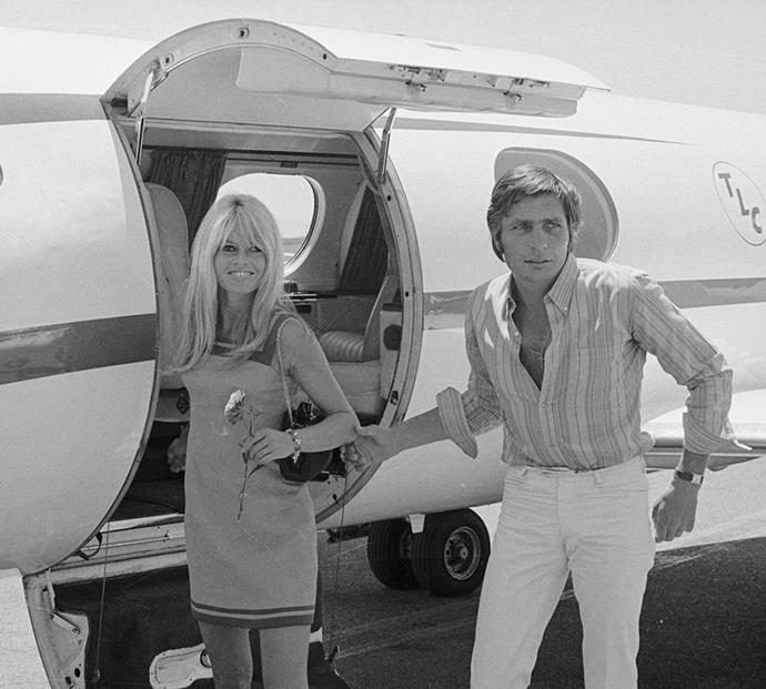 Brigitte Bardot and Gunther Sachs von Opel departing for Mexico and Tahiti in July 1966