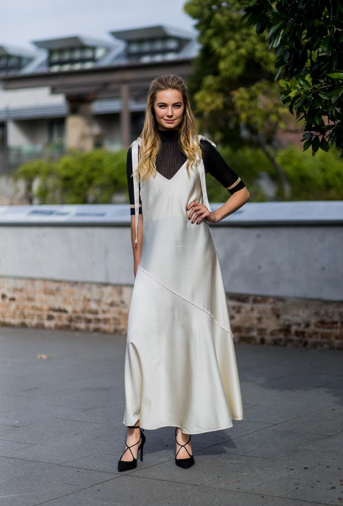 ***Under a slip dress***<bR> During the warmer months, we practically lived in our silk slip dresses. So why should we retire them just because it's a bit nippy? Take a cue from Bridget Malcolm and layer a turtleneck underneath to extend the longevity.
