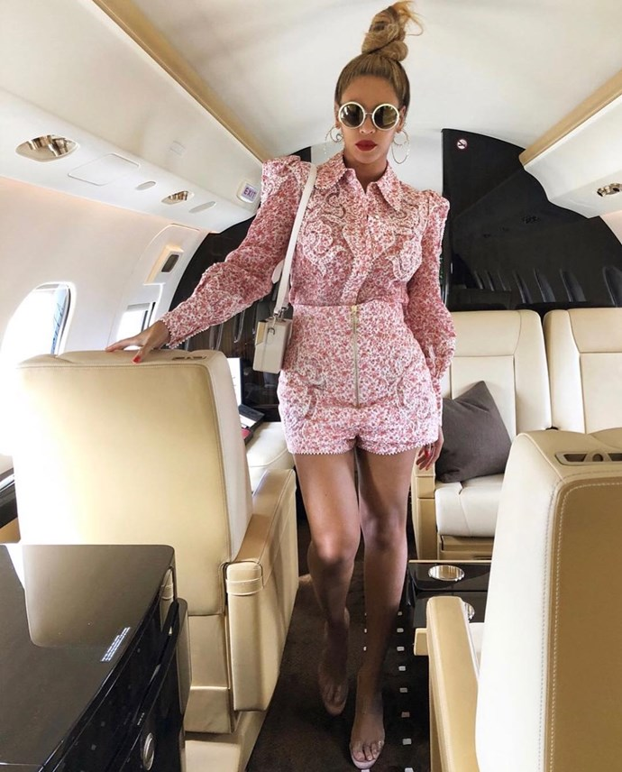 """**Zimmermann**  <br><Br> While travelling, Beyoncé is spotted wearing the radiate appliqué shirt and shorts from Zimmermann's Spring/Summer 2018 collection.  <br><Br> You can buy the shirt for $1,125 [here](https://www.zimmermannwear.com/radiate-applique-shirt-watermelon-ditsy-floral.html