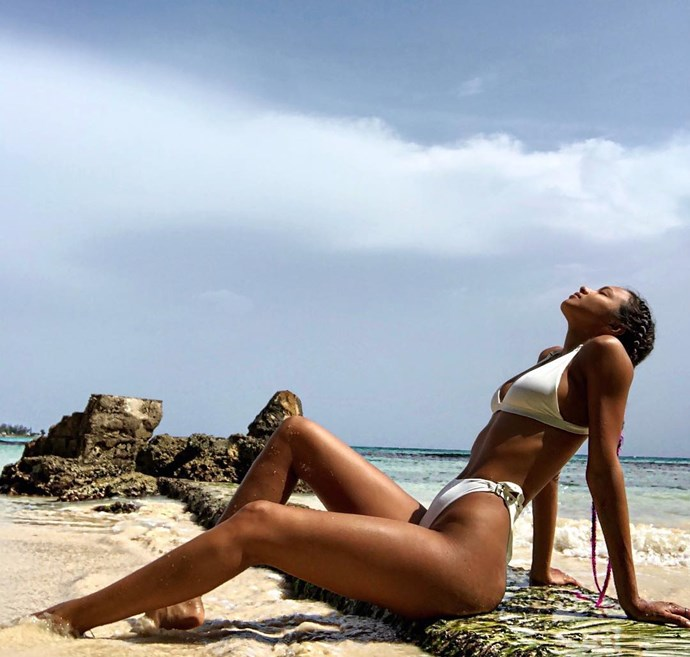 Lais Ribeiro lays on the beach in Jamaica.