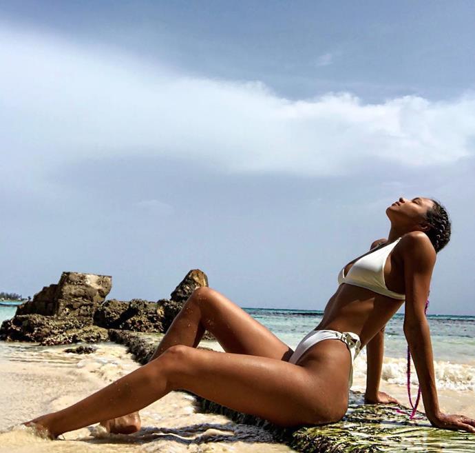 Lais Ribeiro lays on the beach in Jamaica.