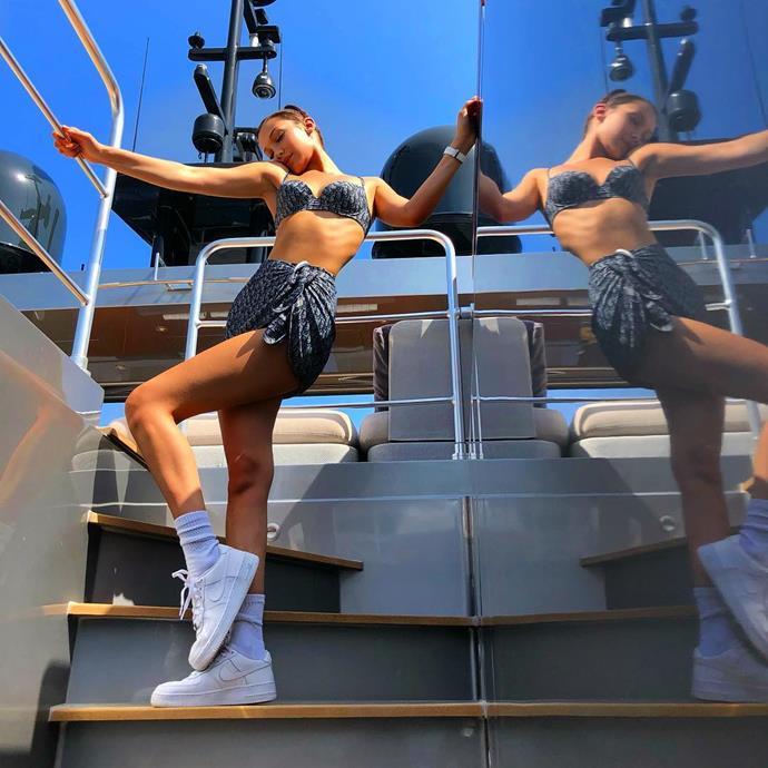 Bella Hadid opts for vintage swimwear on board a yacht.