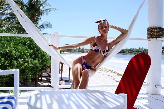 Devon Windsor relaxing in a tropical destination.