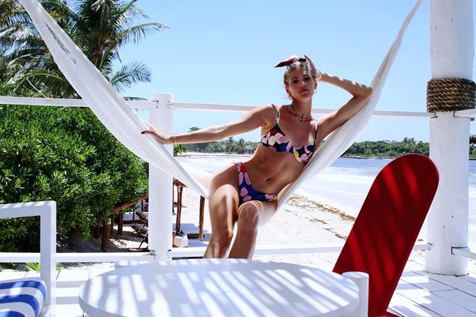 Devon Windsor relaxing in a tropical destination.