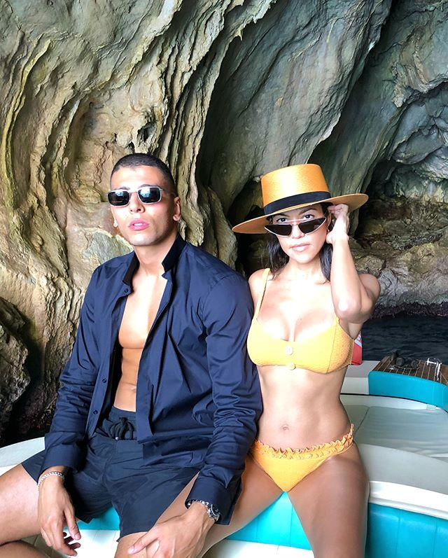 "In a Janessa Leone hat, Lisa Marie Fernandez bikini and dramatic cat-eye sunglasses.  <br><br> *Image: [@kourtneykardash](https://www.instagram.com/p/BkacyddjI8i/?taken-by=kourtneykardash|target=""_blank"")*"