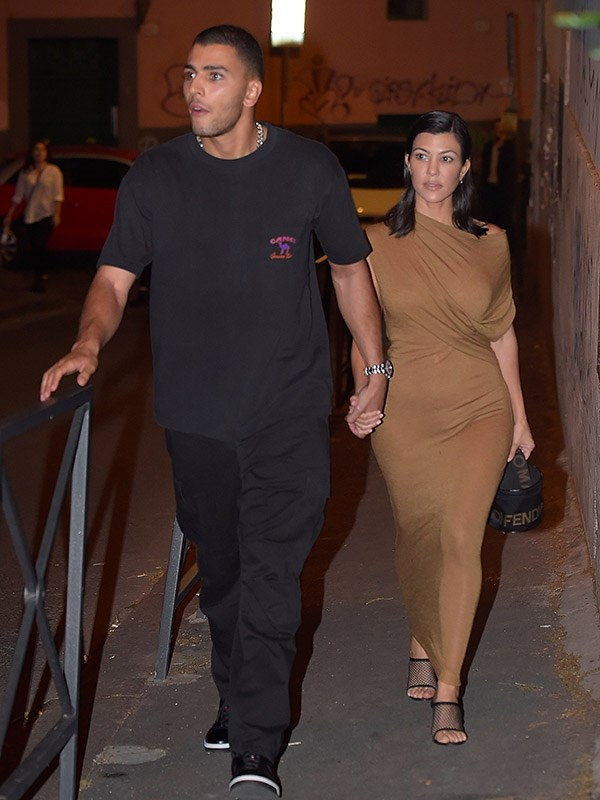 In a Rick Owens dress with a Fendi bag and Yeezy mules.  <br><br> *Image: Getty*