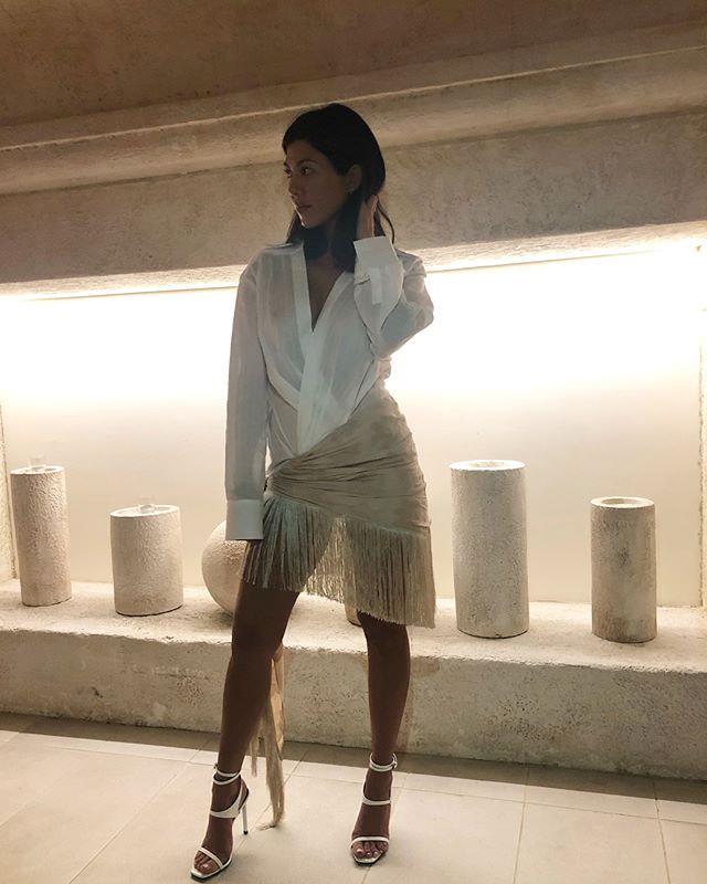 """In a Jacquemus shirt dress with Saint Laurent heels.  <br><br> *Image: [@kourtneykardash](https://www.instagram.com/p/BkdAVxhDRfC/?taken-by=kourtneykardash target=""""_blank"""")*"""