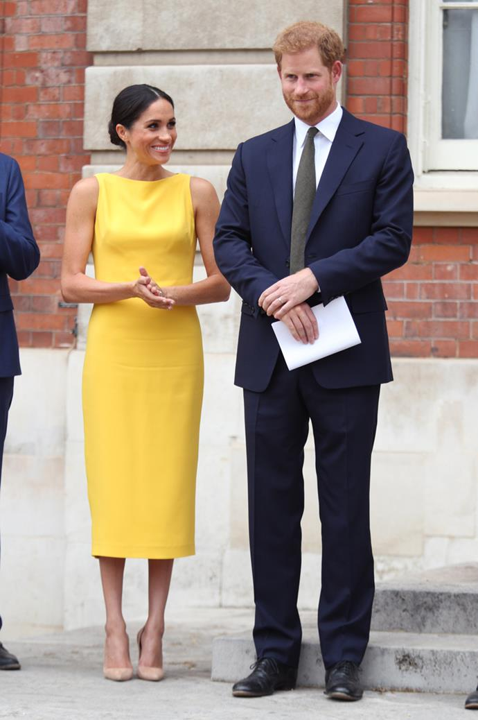 Meghan Markle wearing a marigold Brandon Maxwell number at the Your Commonwealth Youth Challenge reception at Marlborough House on 5th July, 2018