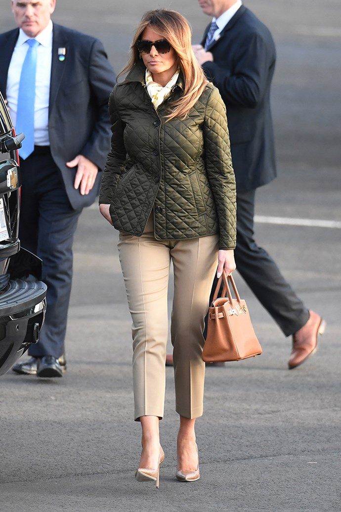 Melania Trump wears a quilted khaki Burberry jacket with cropped Michael Kors trousers, pumps and her Hermès Birkin as she lands in Glasgow on 13th July, 2018.