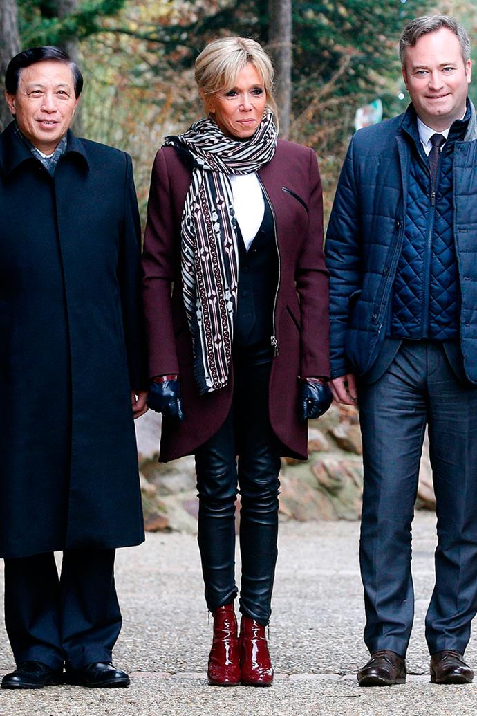 Wearing an oxblood coat with leather trim at at the Beauval Zoo in France on 4 December 2017.