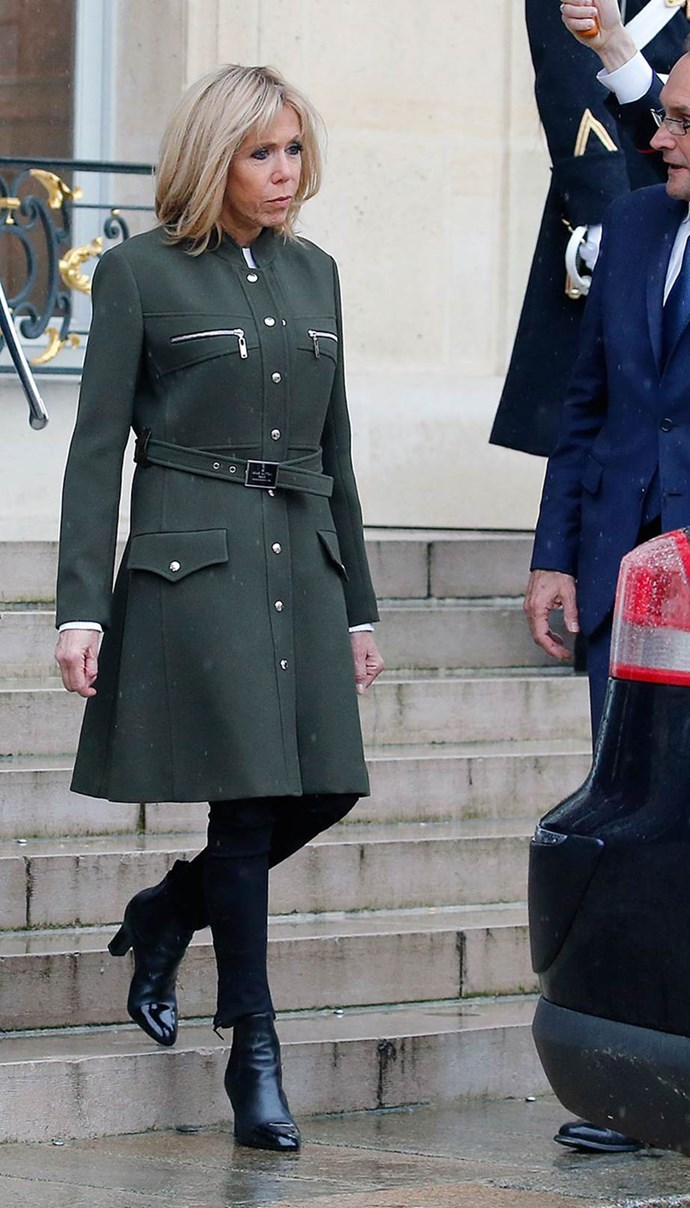 Wearing an olive Louis Vuitton coat dress while greeting three Baltic leaders at the Elysée Palace on 9 April, 2018.