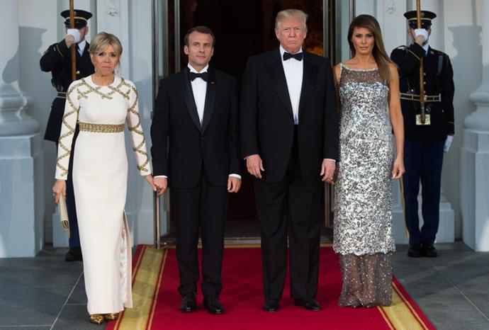 Wearing an ivory Louis Vuitton gown, complete with gold sequin crossover embellishment for a State Dinner at the  White House on 24 April, 2018.