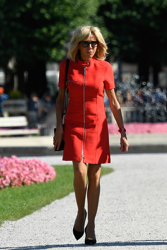 Wearing a piercing red mini dress, complete with a biker jacket collar in Salzburg on 23 August, 2017