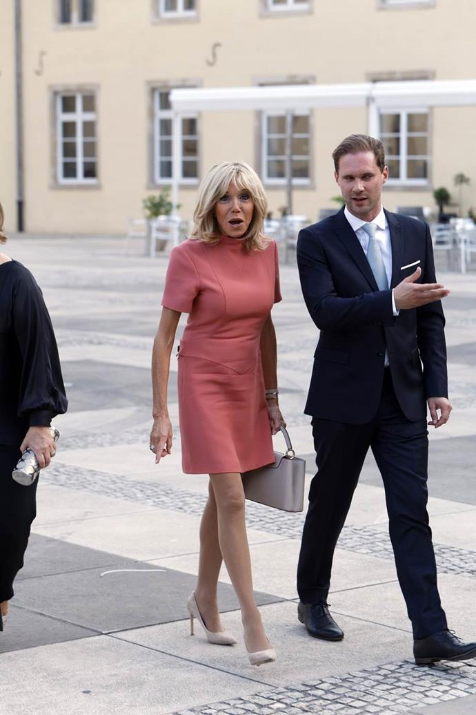 Wearing a salmon-pink Louis Vuitton mini dress during an official visit to Luxembourg on 29 August 2017.