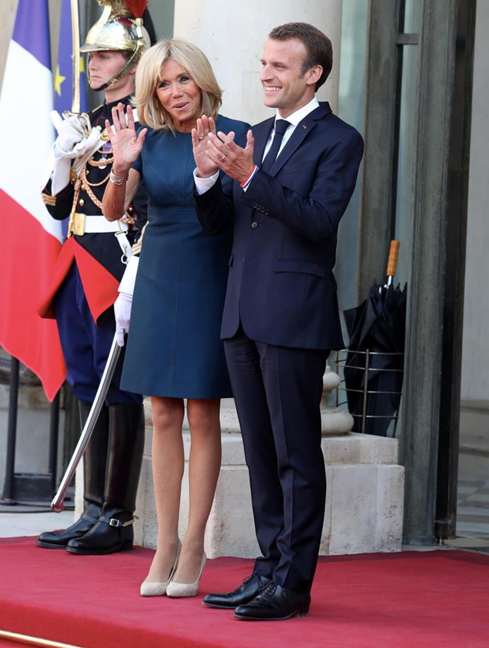 Wearing a navy Louis Vuitton mini to receive France's national football team at Elysée Palace on 16 July 2018, following their FIFA World Cup win.