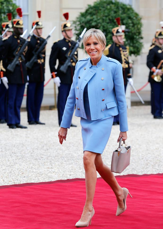 Wearing a powder blue Louis Vuitton skirt suit for the inauguration of Emmanuel Macron at Elysée Palace on 7 May, 2017.