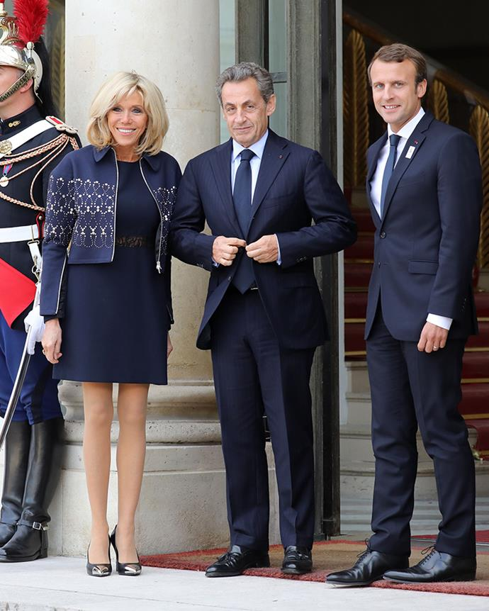 Wearing a navy mini dress and embellished cropped jacket, which she paired with Louis Vuitton pumps, at the Elysée Palace on September 15, 2017.