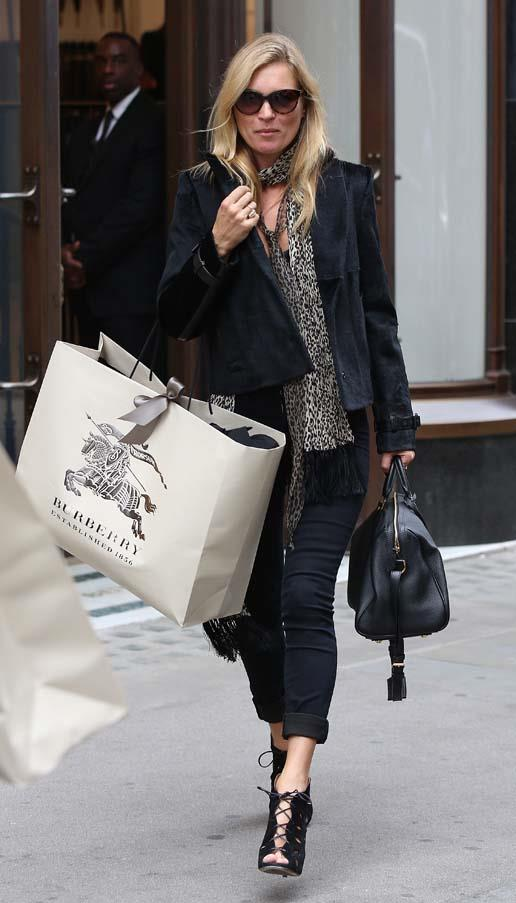 Leaving the Burberry store on Regent Street, September 2014.
