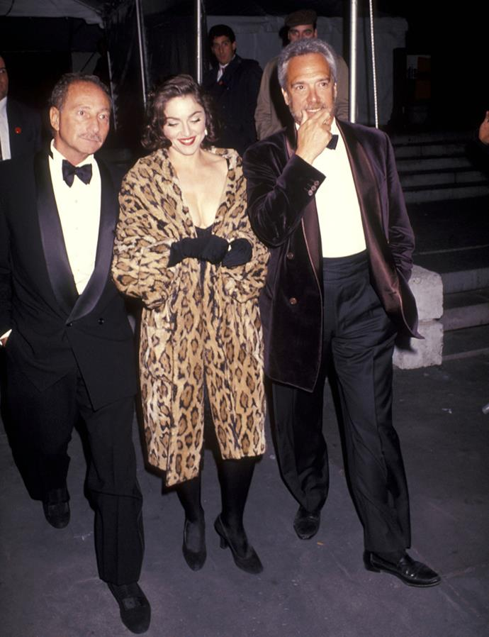 ***Add a rock-and-roll twist with leopard faux fur***<br><br> As long as your friends aren't marrying in an ultra-conservative ceremony and are okay with you toeing the sartorial line, why not dress up a plain black look with some rock-and-roll faux fur? Madonna's 1991 look to a friend's City Hall wedding proves it can be done.