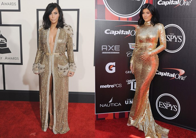 Kim Kardashian and Kylie Jenner in floor-length gold sequins.