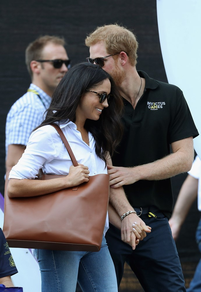Prince Harry and Meghan Markle hold hands during the Invictus Games 2017 at Nathan Philips Square in Toronto on 25 September, 2017.