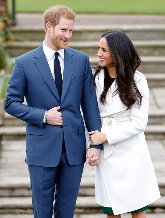 Prince Harry and Meghan Markle link hands at an official photocall to announce their engagement at The Sunken Gardens, Kensington Palace on 27 November, 2017.