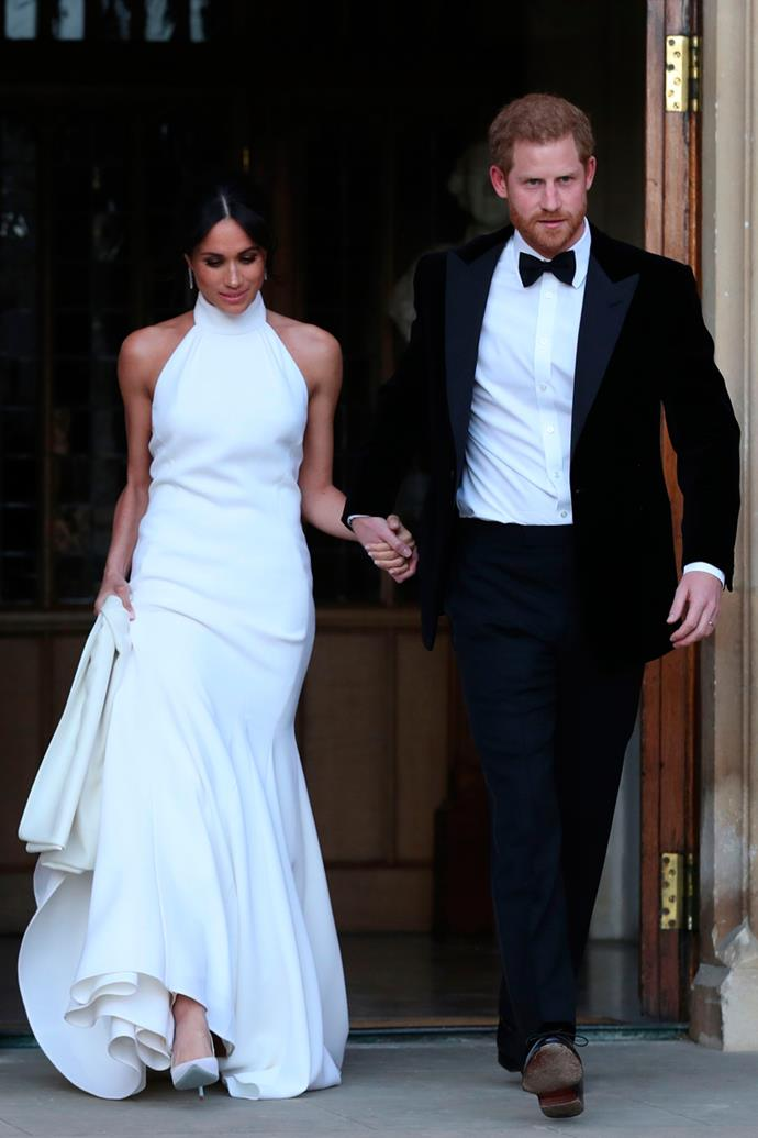 Prince Harry and Meghan Markle leave Windsor Castle holding hands after their wedding for an evening reception at Frogmore House on 19 May, 2018.