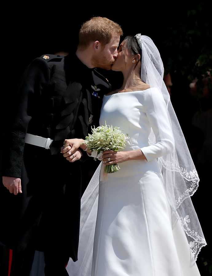Prince Harry and Meghan Markle kiss outside St George's Chapel in Windsor Castle after their wedding on 19 May, 2018.