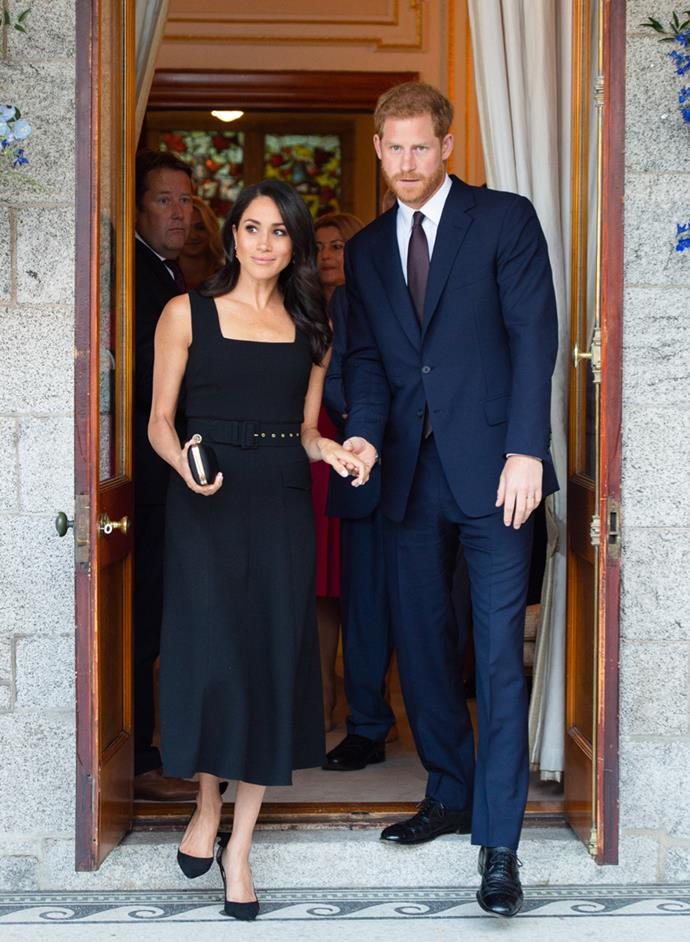 Prince Harry and Meghan arrive holding hands at the British Ambassador's residence at Glencairn House during their visit to Ireland on 10 July, 2018.