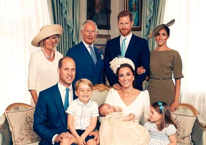 Meghan Markle loops her hand through Prince Harry's arm during the official portraits to celebrate Prince Louis' christening on 9 July, 2018.