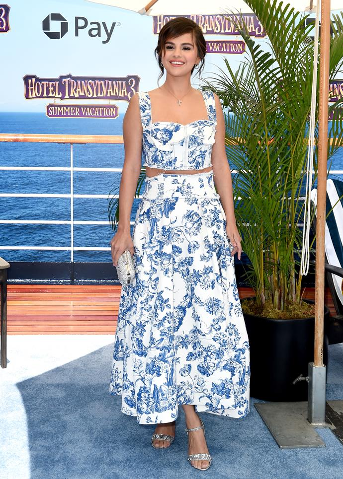 **July 3rd, 2018**  Selena opted for a printed two-piece by Oscar de la Renta to attend the premiere of *Hotel Transylvania 3*.