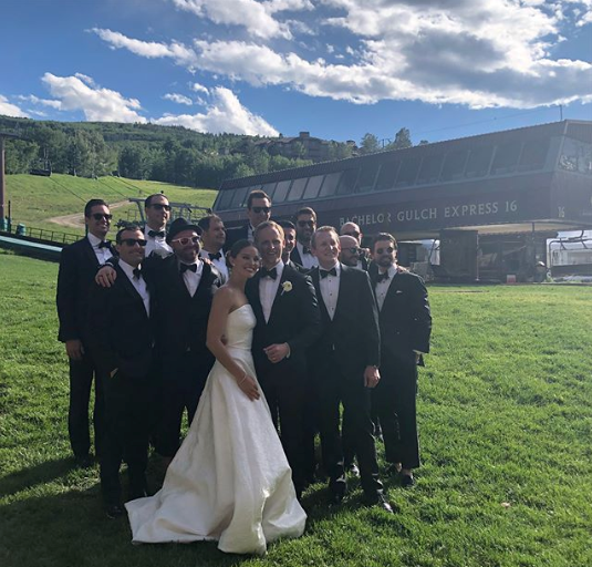 The bride and the groomsmen pose near the ski lift.  (PHOTO: INSTAGRAM)