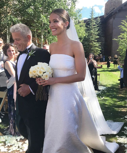 The bride's father walks her down the aisle.  (PHOTO: INSTAGRAM)