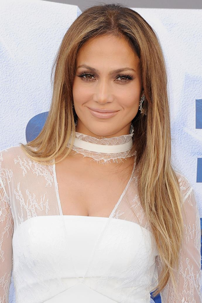 JLo attended a premiere in 2016 sporting her go-to bronze smokey eye and nude glossy lips.