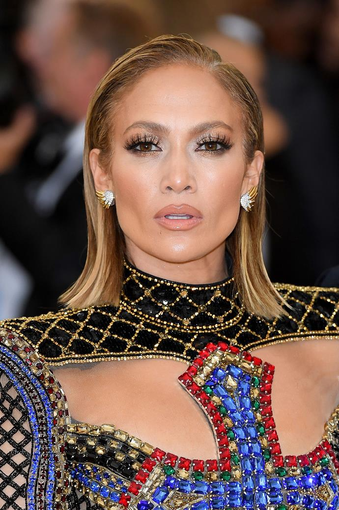 JLo paired her trademark nude lip and neutral smokey eye with a sleek bob at the 2018 Met Gala. Let's be honest, her beauty over the years has always been spot on.