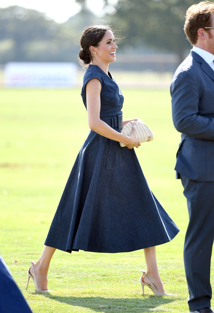 **2018** <br><br> The Duchess of Sussex attends the Sentebale ISPS Handa Polo Cup at the Royal County of Berkshire Polo Club in Windsor, wearing a Carolina Herrera belted dress and a J. Crew clutch.