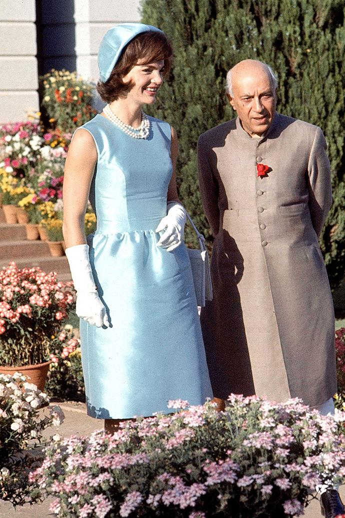 Walking with Indian Prime Minister Jawarhalal Nehru in the garden of his residence, 1962