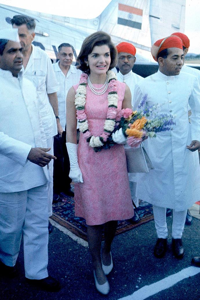 Being met by the Maharaj of Mewer on her arrival to India, 1962