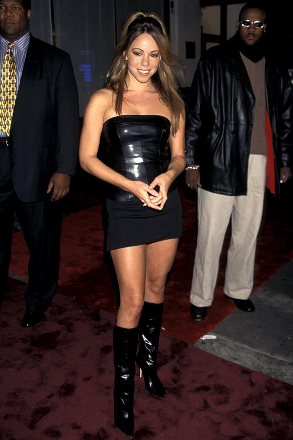 Mariah Carey in a latex and fabric minidress, 1997.