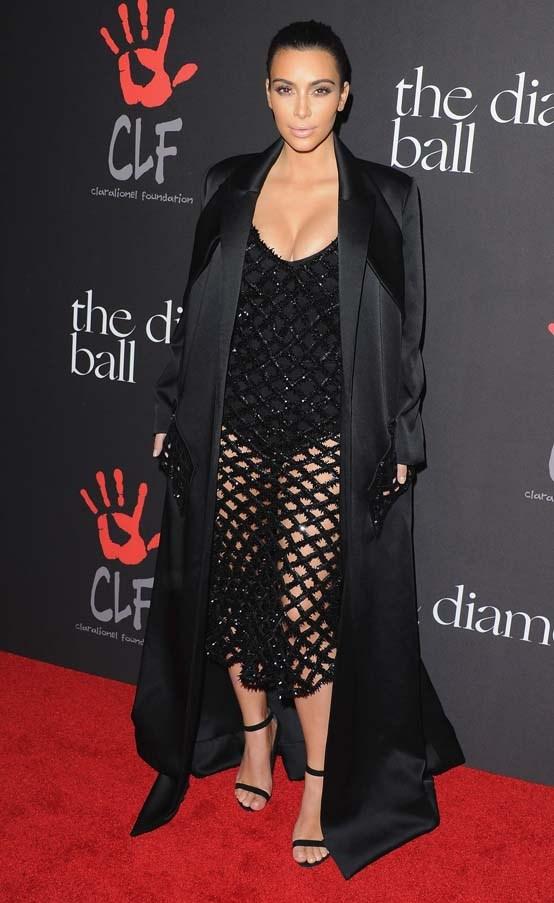 At Rihanna's 'Annual Diamond Ball', December 2014.