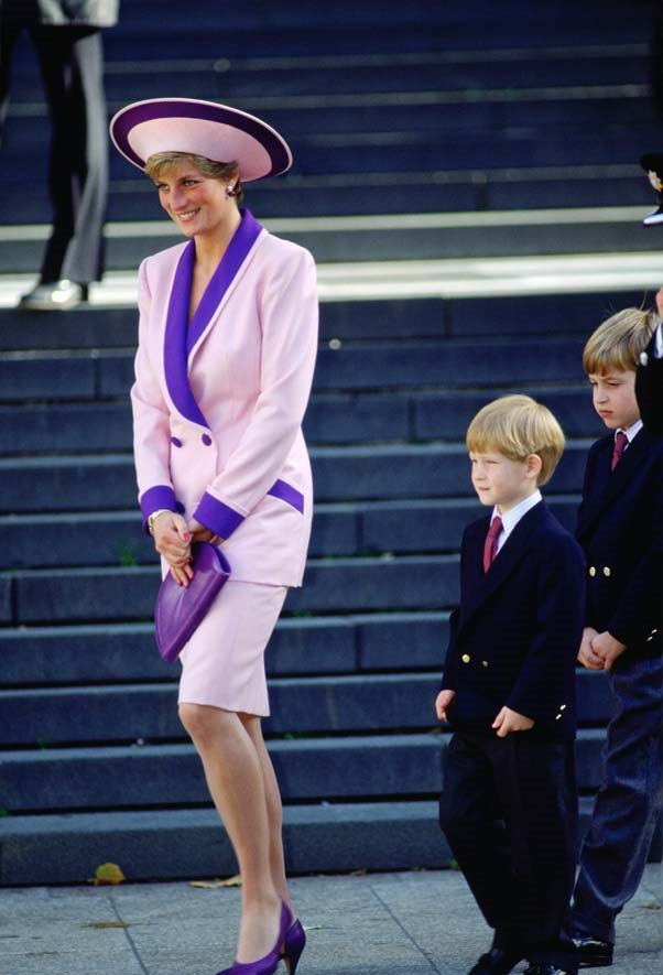 In Catherine Walker with Prince William and Prince Harry in London, 1990.