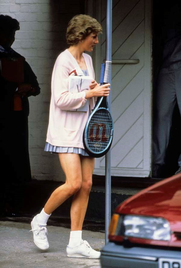 Playing tennis in London, 1988.