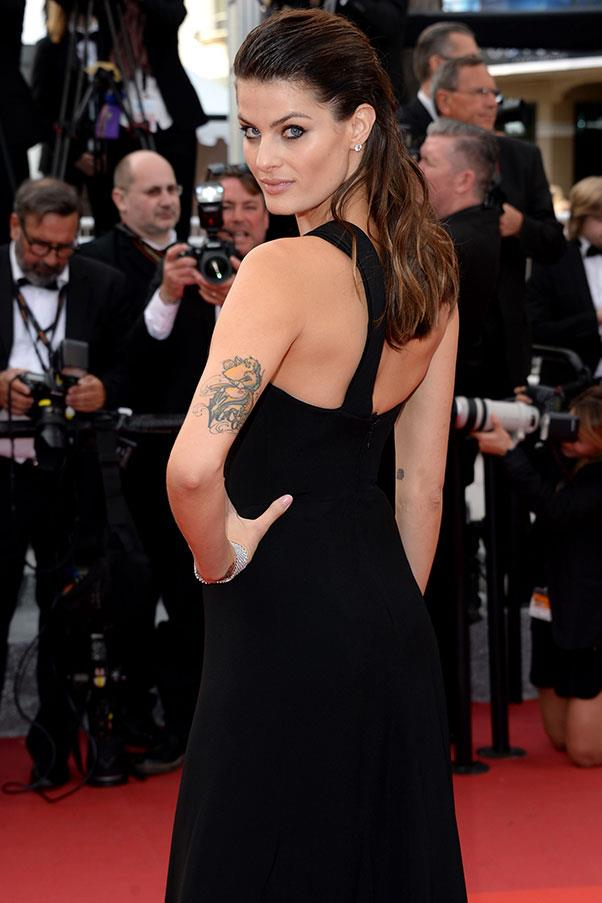 **Isabeli Fontana** <br><br> Brazilian model Isabeli Fontant has six tattoos, including a heart on her wrist and vines on her ankle. Two of the tattoos—a teddy bear on her left arm and wings on her back—are tributes to her sons, Lucas and Zion.