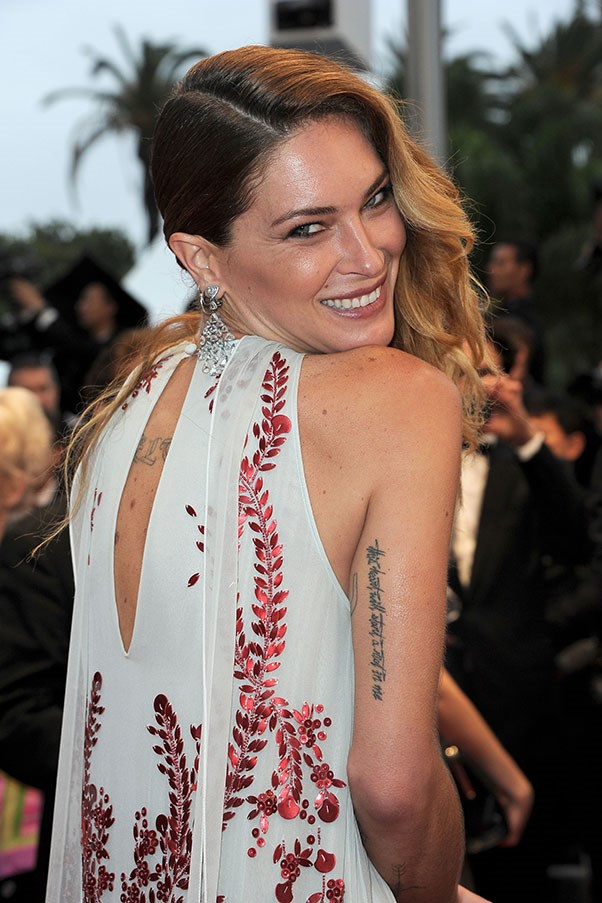 **Erin Wasson** <br><br> Wasson is another model famous for her ink, having several tattoos across her back and arms. She told *BAZAAR* in 2016 that she has kept most of the ink to her back so it's less obvious in her modelling work.