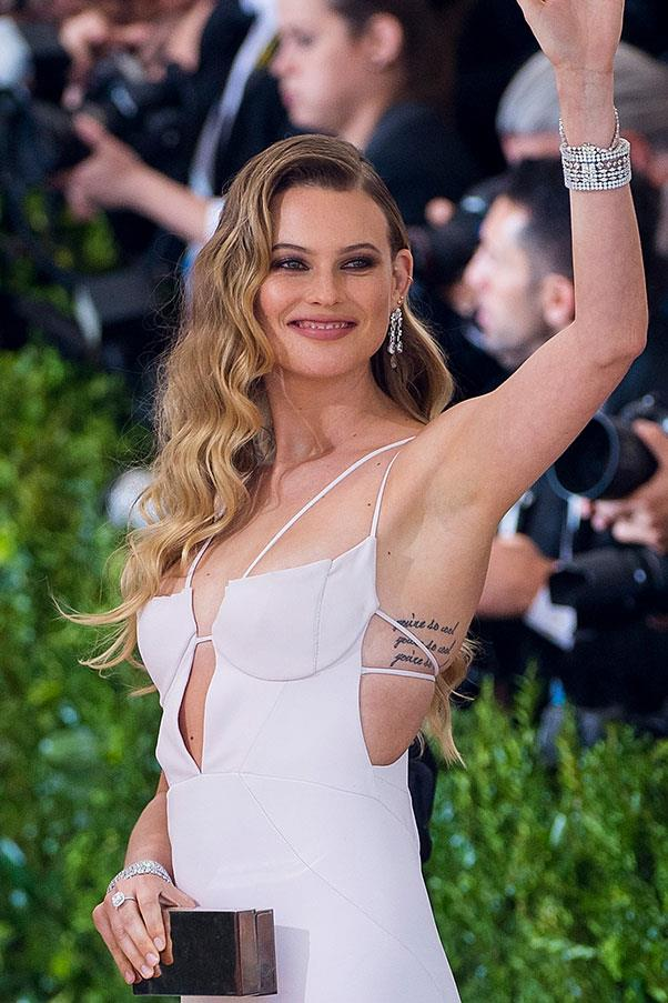 **Behati Prinsloo** <br><br> Behati Prinsloo's husband, Adam Levine, may be known for being *covered* in tattoos, but the Victoria's Secret Angel has a few of her own. On her left wrist she has 'Dusty', the name of her first daughter, and on her ribs she has the phrase 'You're so cool' written three times.