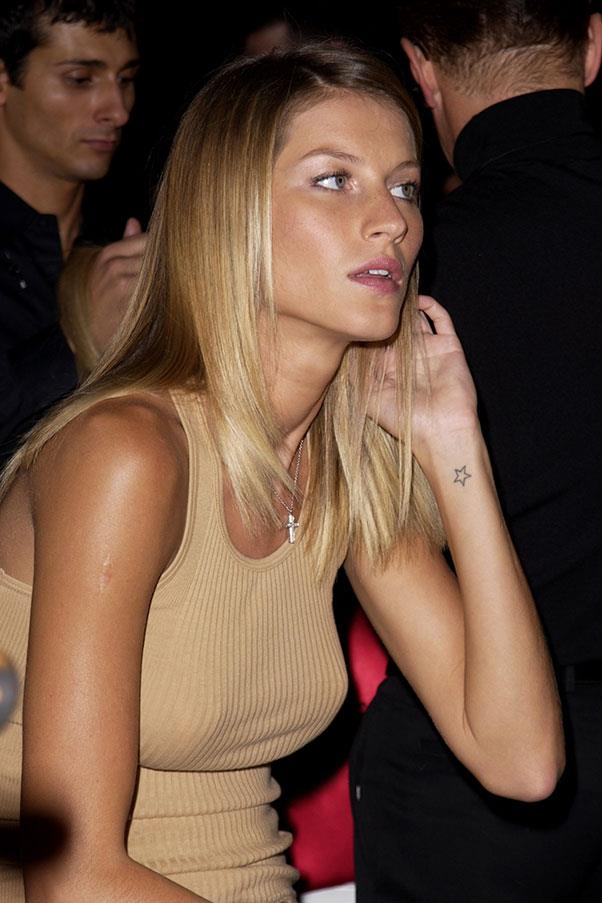 **Gisele Bündchen** <br><br> Having a tattoo seems out of character for Gisele, but the Brazilian has a small star tattooed to her left wrist. The ink dates back to the '90s, when she made several red carpet appearances with then-boyfriend Leonardo Dicaprio.