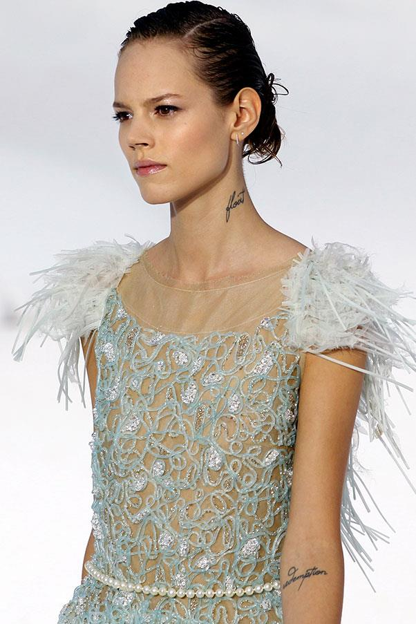 **Freja Beha Erichsen** <br><br> Freja Beha Erichsen, the Danish model who was a runway heavyweight in the late noughties, has perhaps the best-known model tattoo. The word 'Float' is tattooed to her neck, alongside other tattoos on her inner-elbow and bicep.