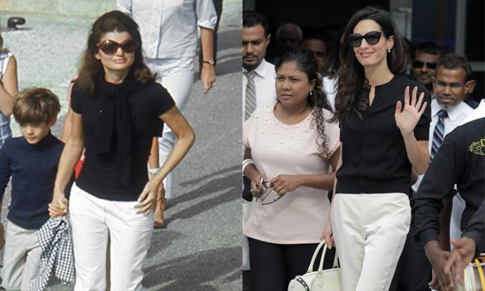 Amal Clooney's off-duty style looks very familiar, with Clooney wearing Jackie O's go-to black tee, oversized shades and ivory trouser ensemble in the Maldives on 7th September, 2015. <br><br> Images: Getty